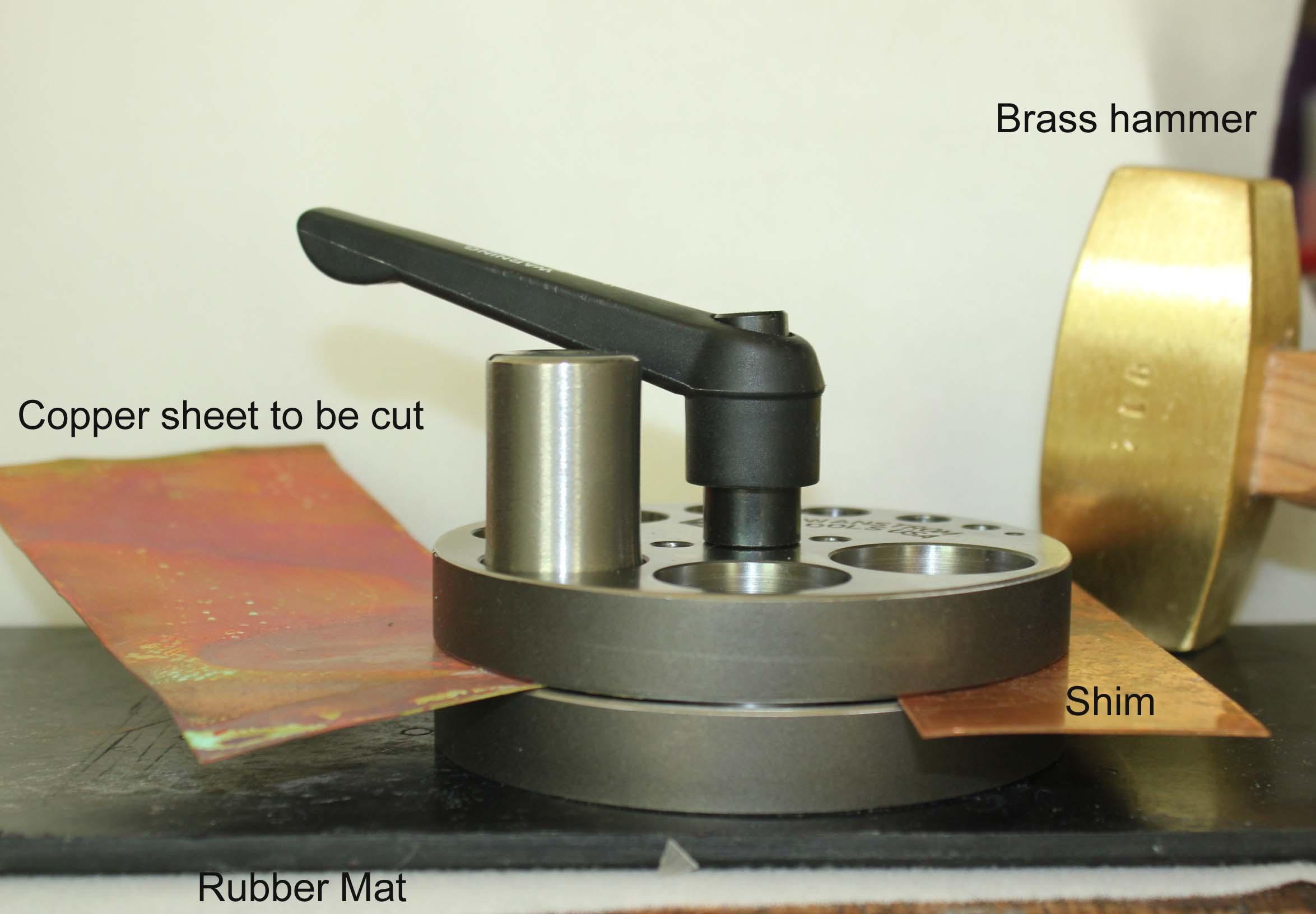 Disc cutter, copper sheet, shim, rubber mat, brass hammer