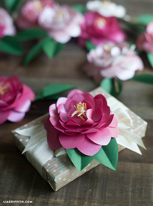 Paper Flowers Embellishing Small Wrapped Packages