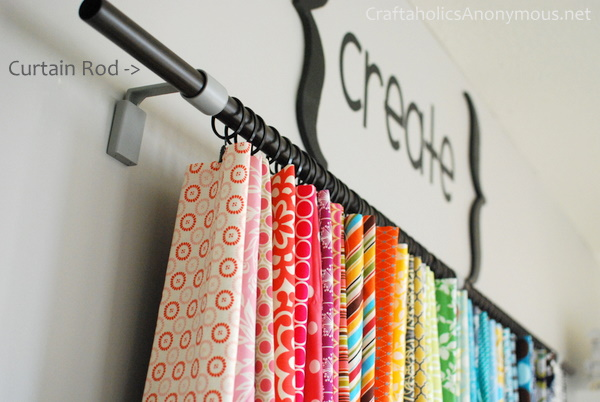 Fabric storage solution using a curtain rod