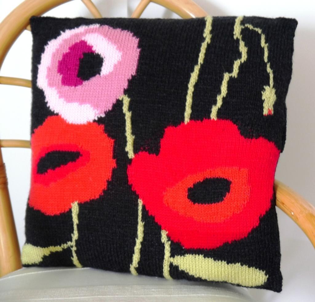 Knit poppy pillow
