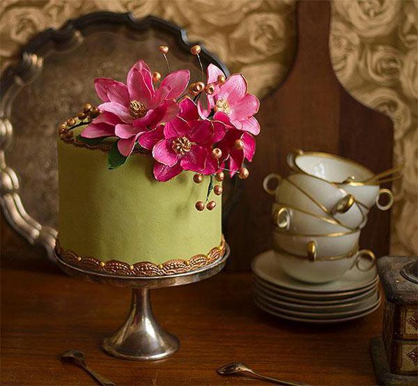 Garden cake with bright pink sugar flowers