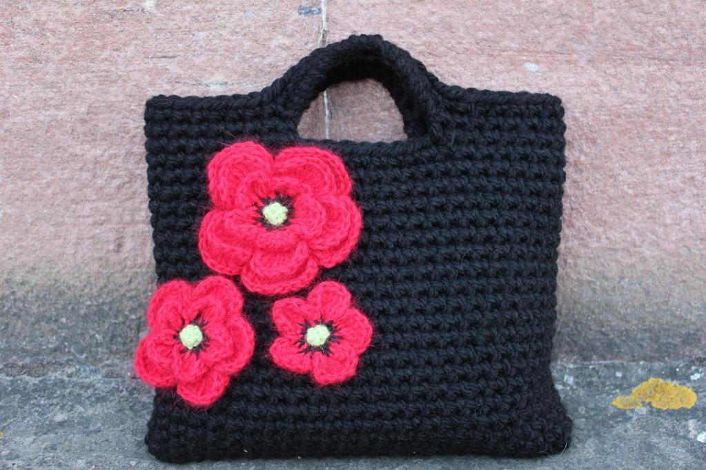 Crochet poppy clutch