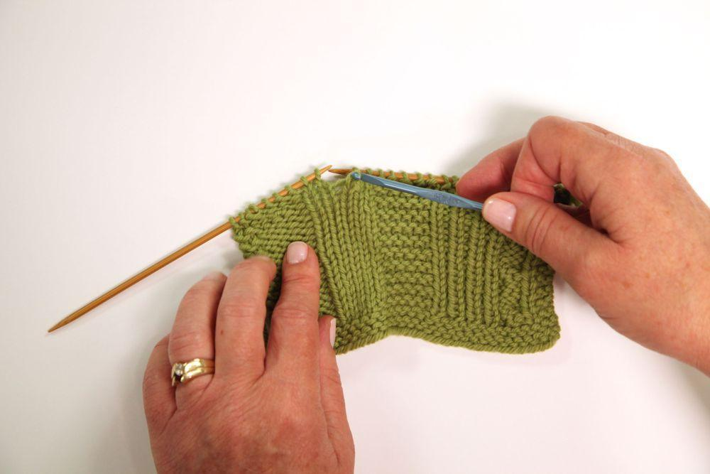 Fixing dropped stitches in knitting