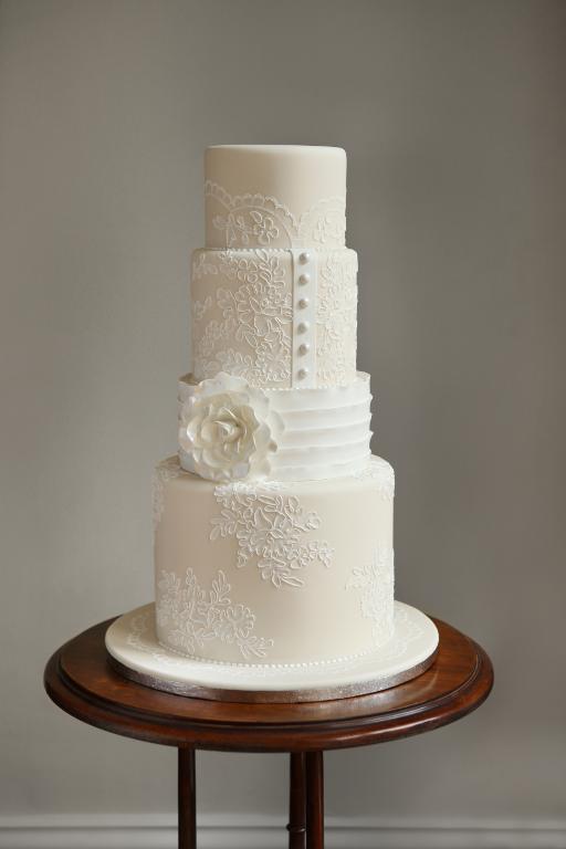 Sleek & Buttoned-up White Wedding Cake
