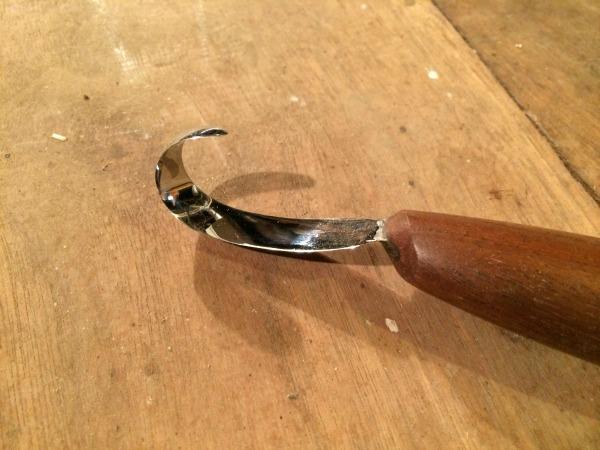 close up of hook knife