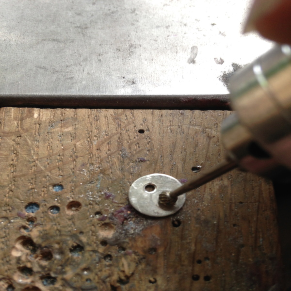 Step Three- After drilling burr the holes