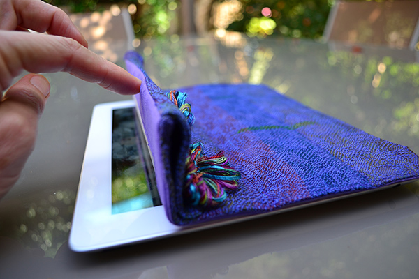 An ipad with a woven cover