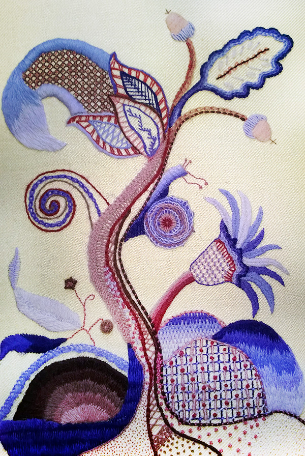 Crewel work tradition: Tree of Life pattern in purple and reds