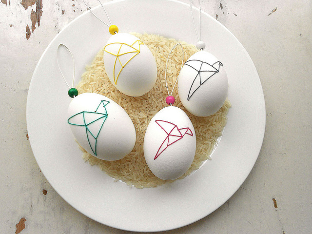 origami style embroidery onto white egg shells