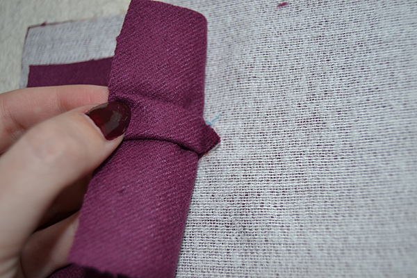 stitch the triangle of the bound buttonhole