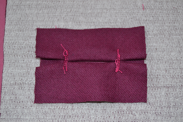the lips of the bound buttonhole are stitched in place