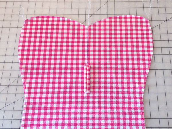 sew tab to front