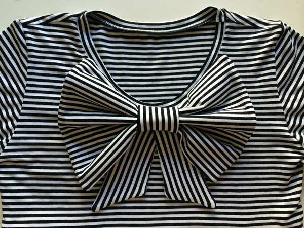 pin bow to dress front