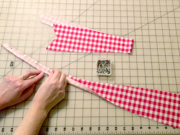 fold and pin straps