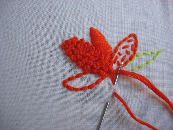 French knots fill a petal.