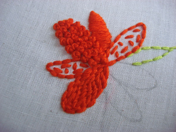 Long and short stitches are shown filling a petal.