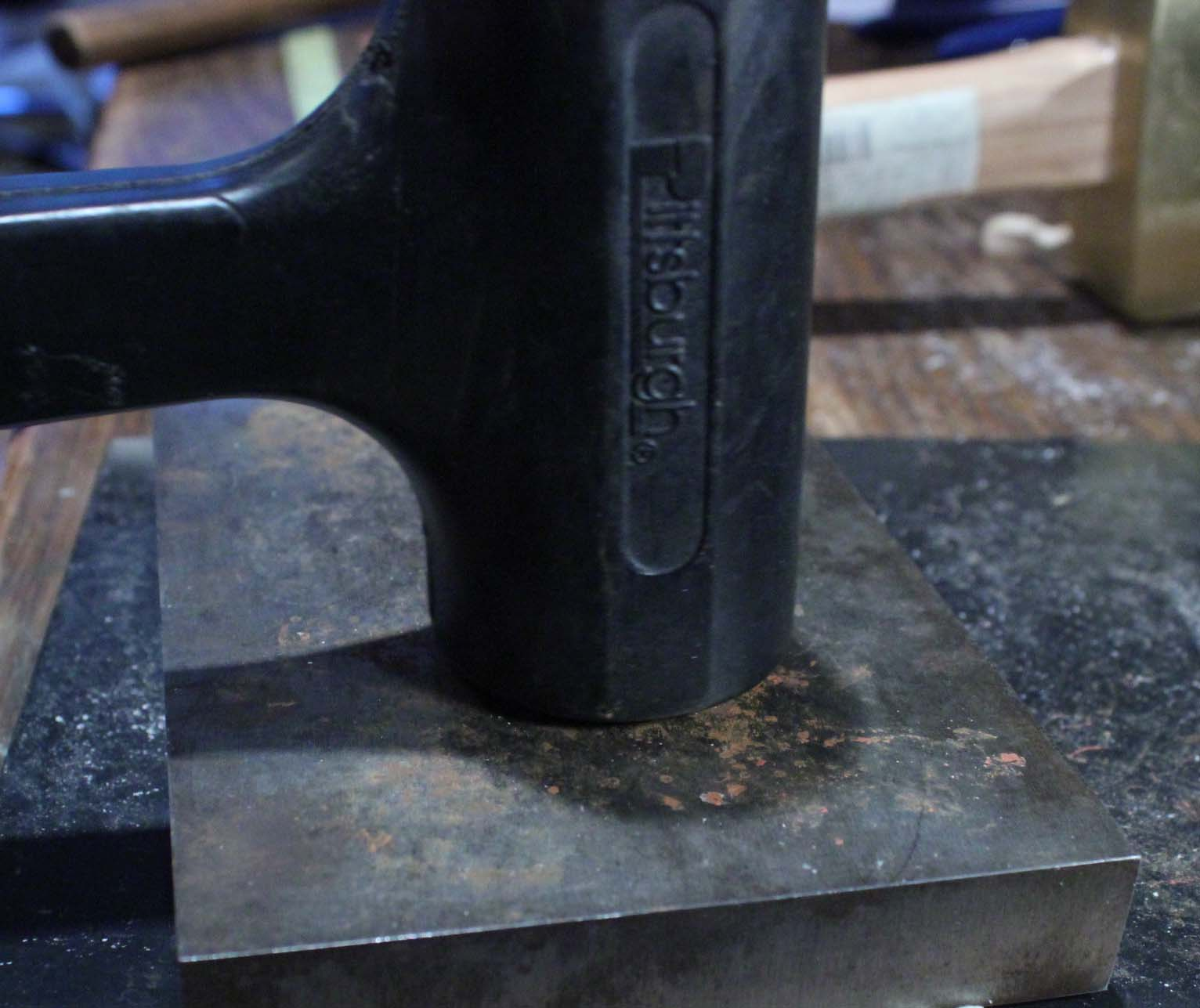 strike metal with rubber mallet