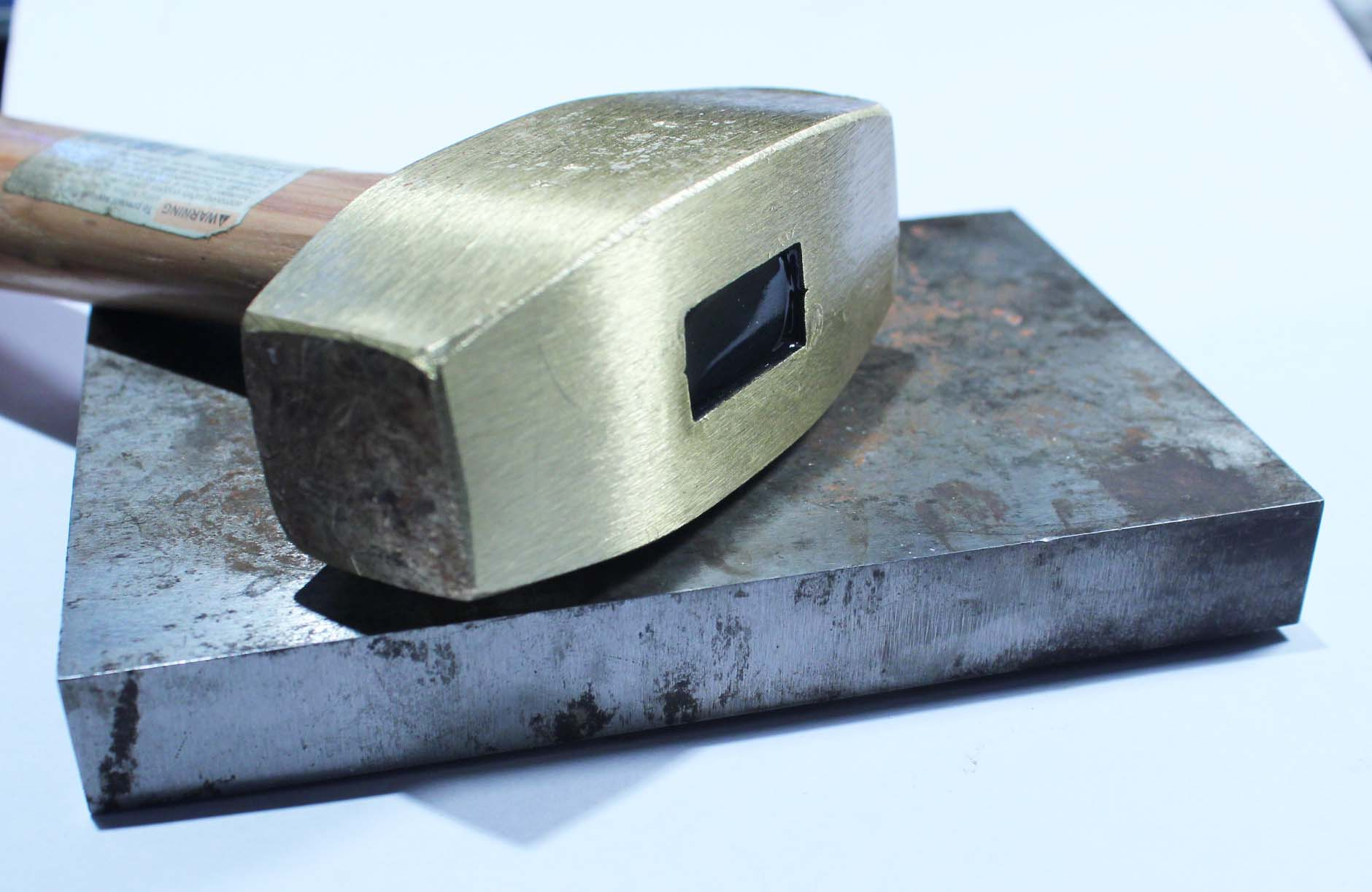 Brass hammer and steel bench block