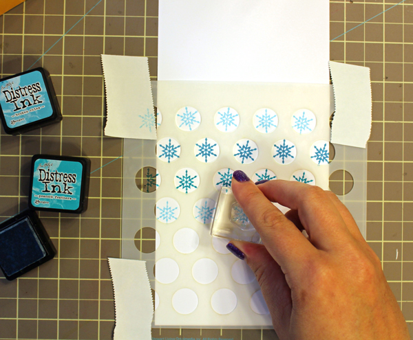 Stamping Snowflakes over a Polka Dot Stencil