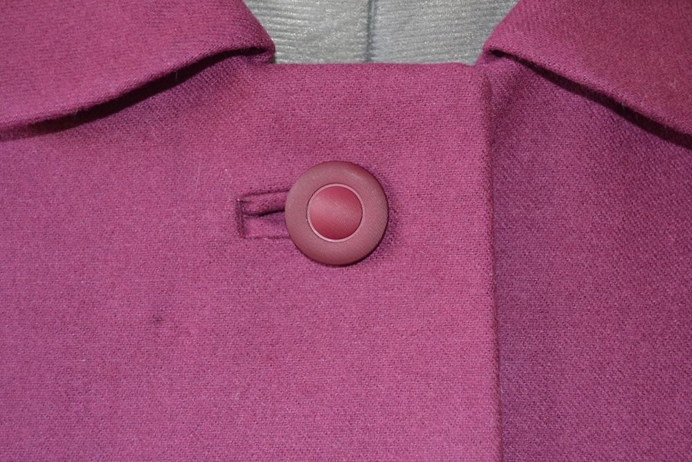 bound buttonhole on pink jacket