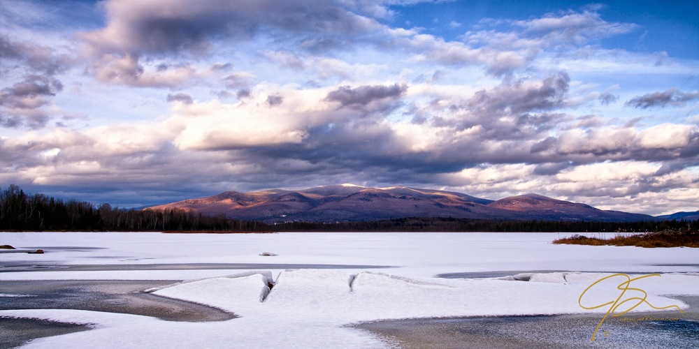 A wide scenic view over Cherry Pond in  northern New Hampshire.