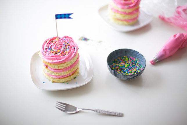 Get ready to dig into a mini cake with pink buttercream frosting