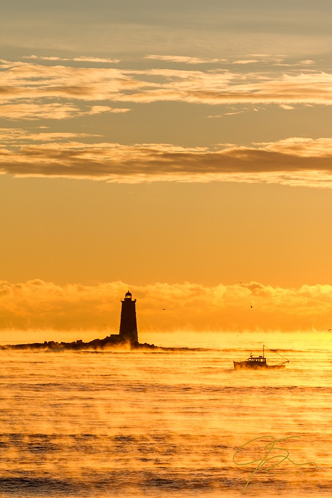 Lobster baot and Whaleback Light on a frigid winter morning.