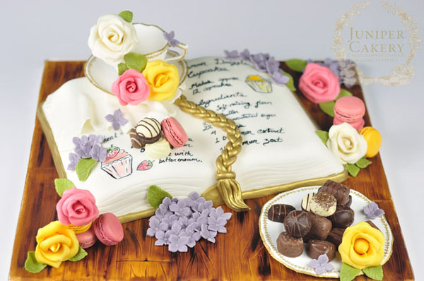 Recipe book cake design with teacups and chocolates!