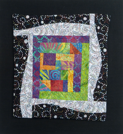 Scrap Quilt with Bright Center and Black and White Borders