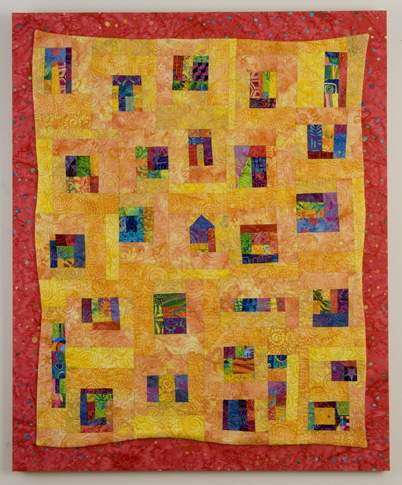 Yellow quilt with splashes of color