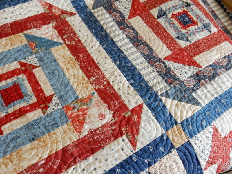 Nested Churn Dash scrap quilt