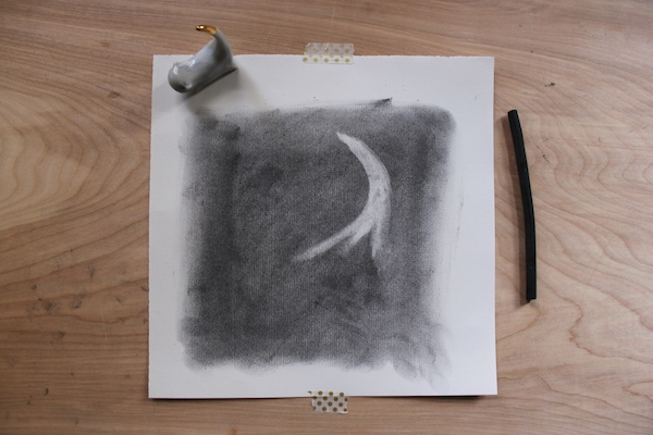 starting to erase forms in charcoal