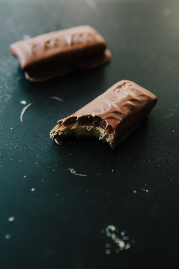 Taking a bite of a homemade twix bar