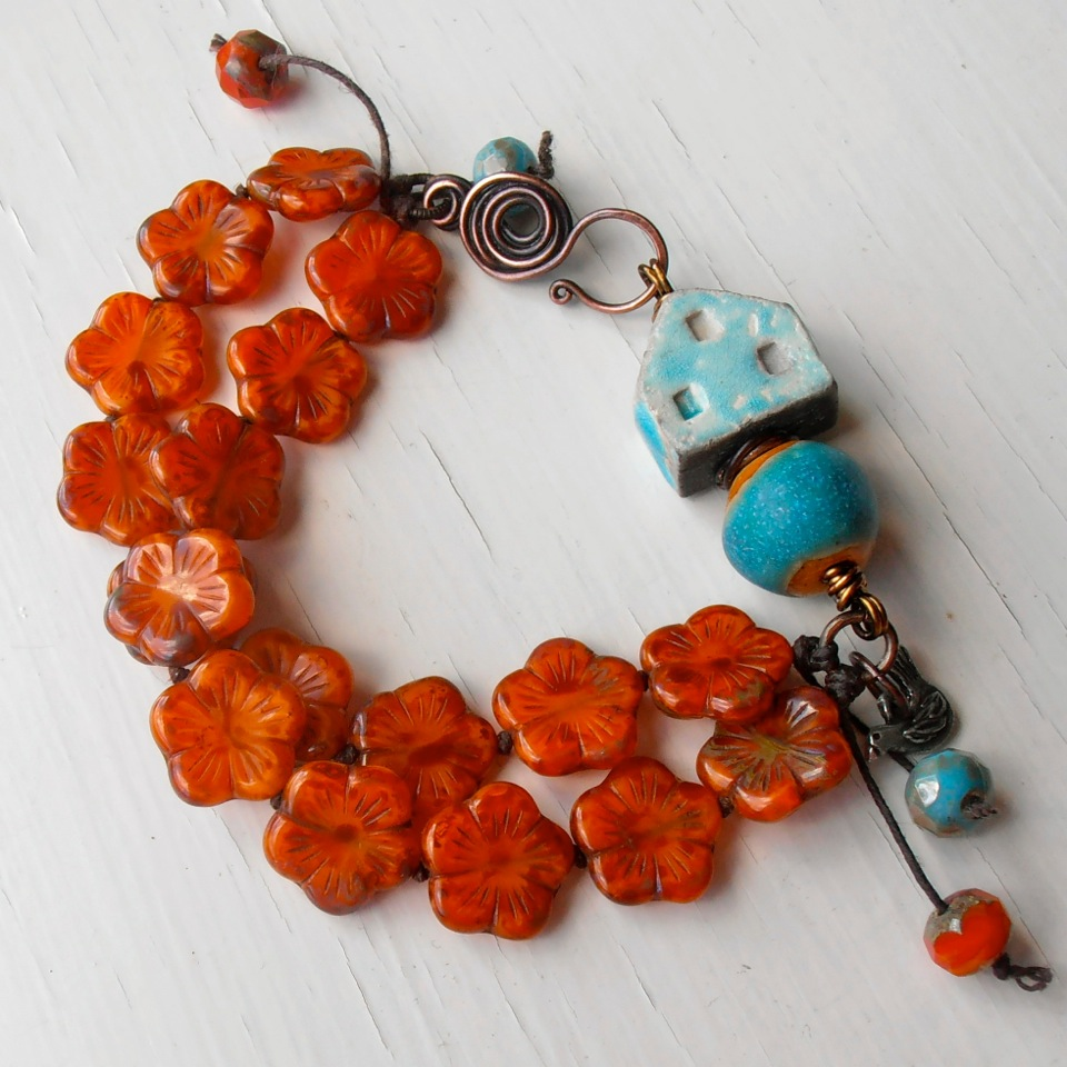 Handmade bracelet featuring artisan beads and handmade copper clasp from The Curious Bead Shop