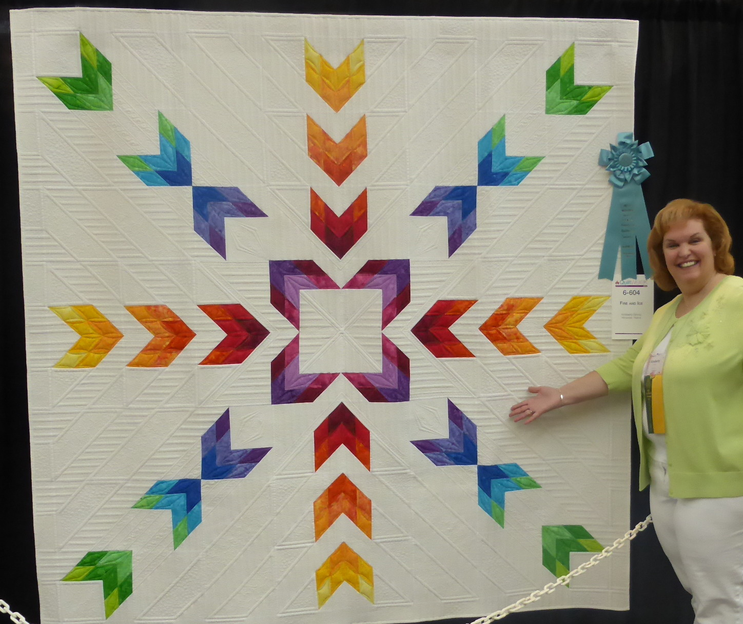 Kimberly Einmo with her award-winning Fire & Ice quilt!