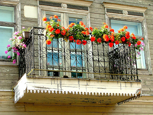 Balcony with red geraniums