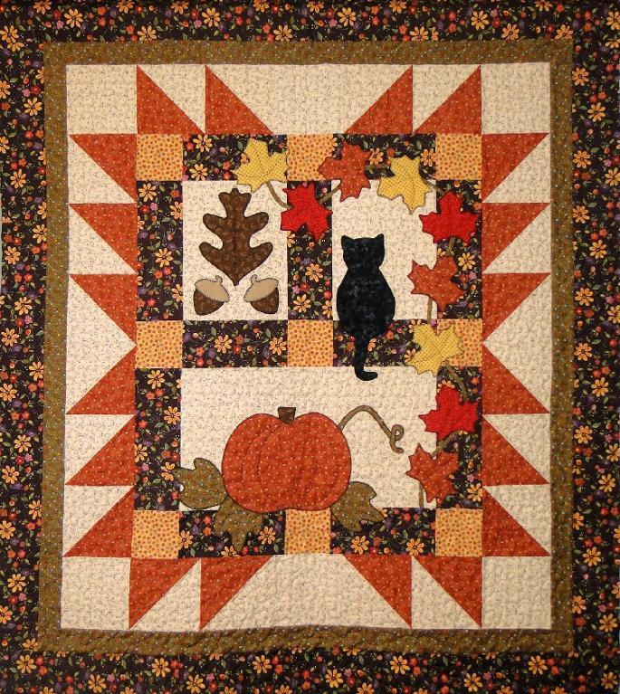 Autumn quilt pattern with pumpkin and cat