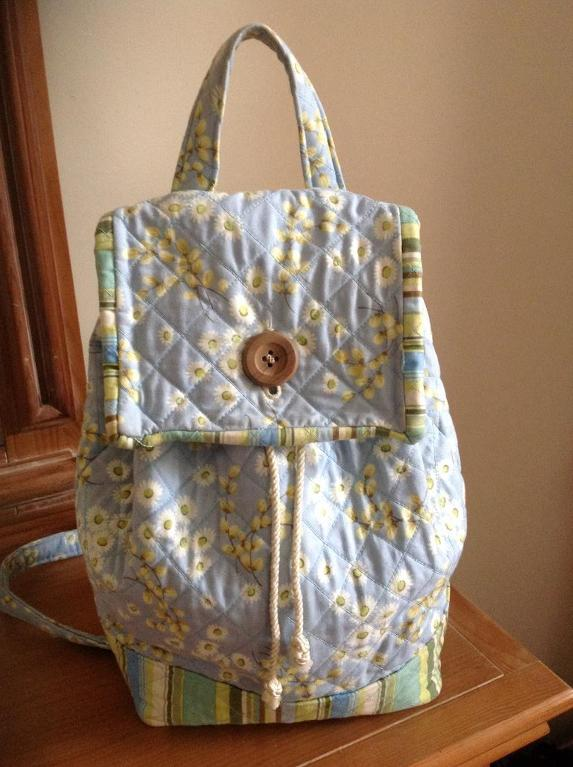 quilted backpack closed with button