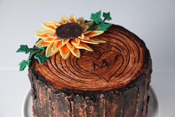 Sunflower and tree trunk cake by Bluprint instructor Erin Gardner