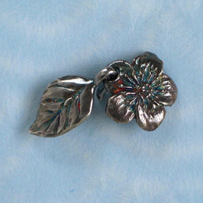 Handmade sterling silver Rose Blossom clasp from Green Girl Studios