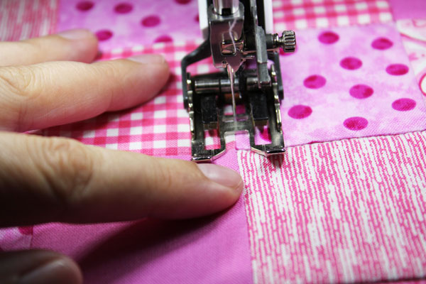 Stitch to the side of the seam allowance