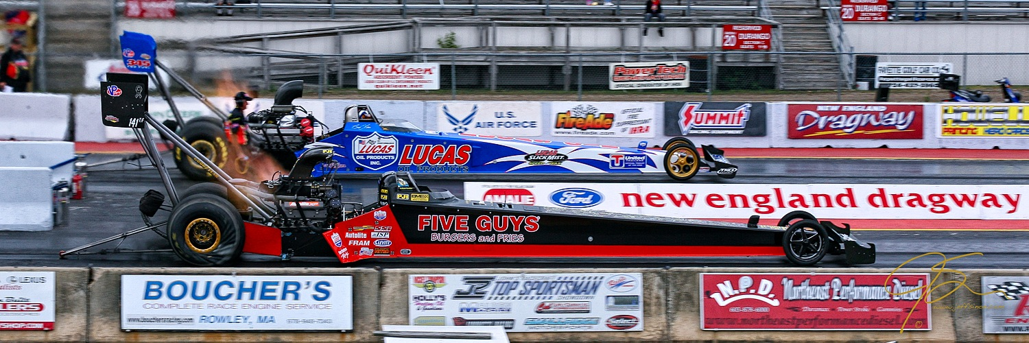 The raw power of a pair of top-fuel dragsters as they leave the starting line