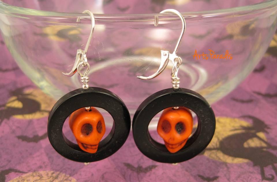 Orange skull earring handmade by Charlene Wood