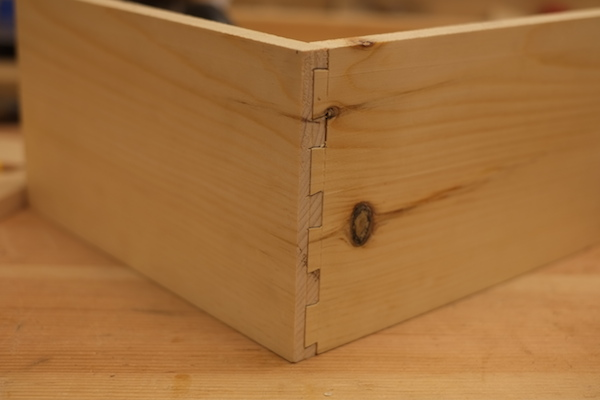 Half-blind dovetail joint hiding a groove