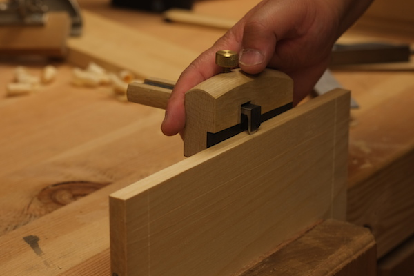 Using a marking gauge to mark the thickness of the board