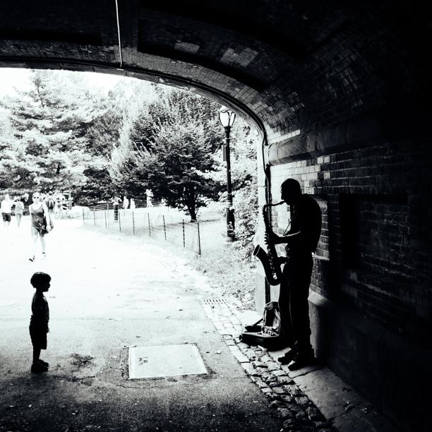 Child watching musician