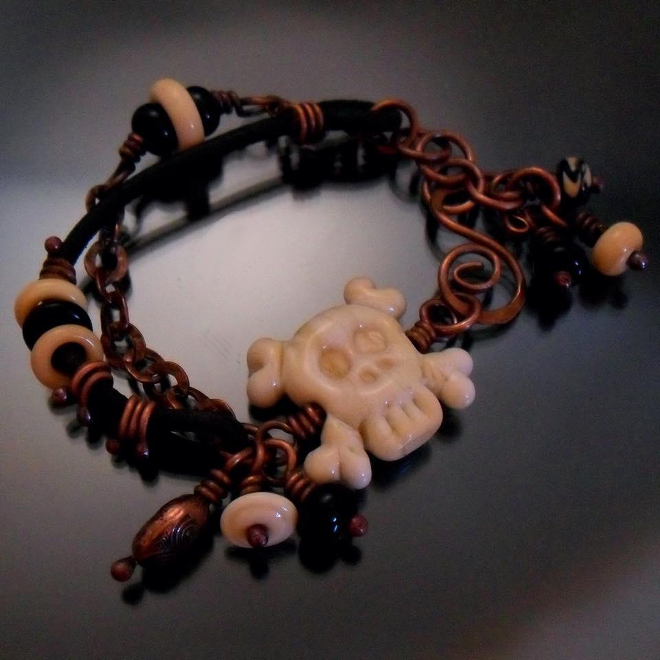 Lampwork skull bracelet handmade by Tracy Bell