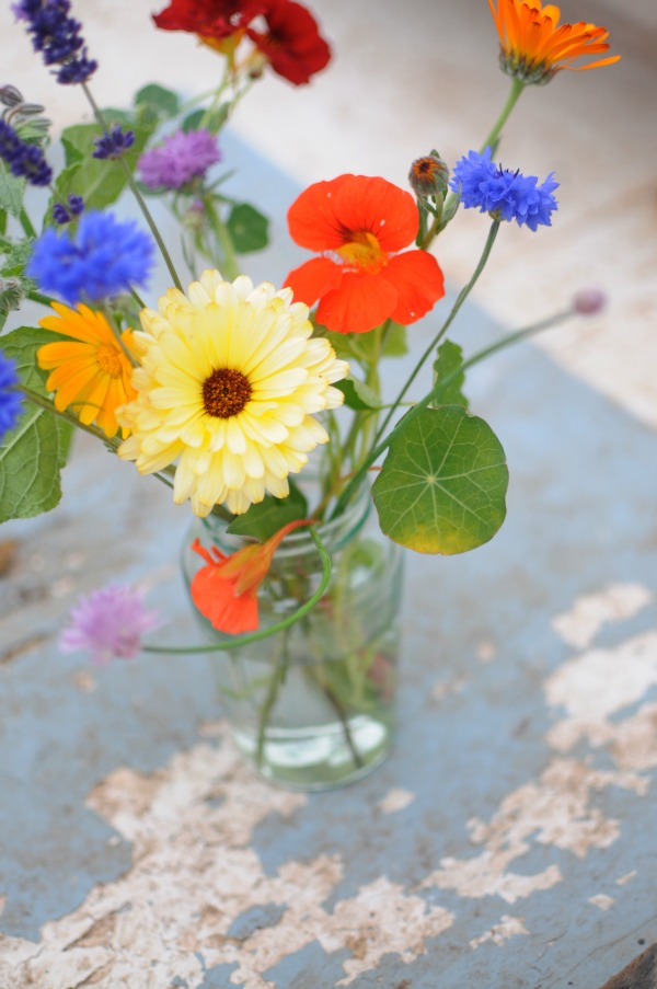 mason jar filled with colorful edible flowers