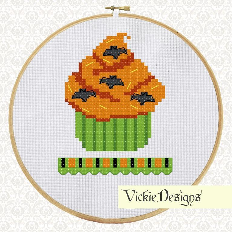 cross stitch pattern of a halloween cupcake with orange frosting and green case.