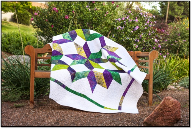 Completed quilt with half squares